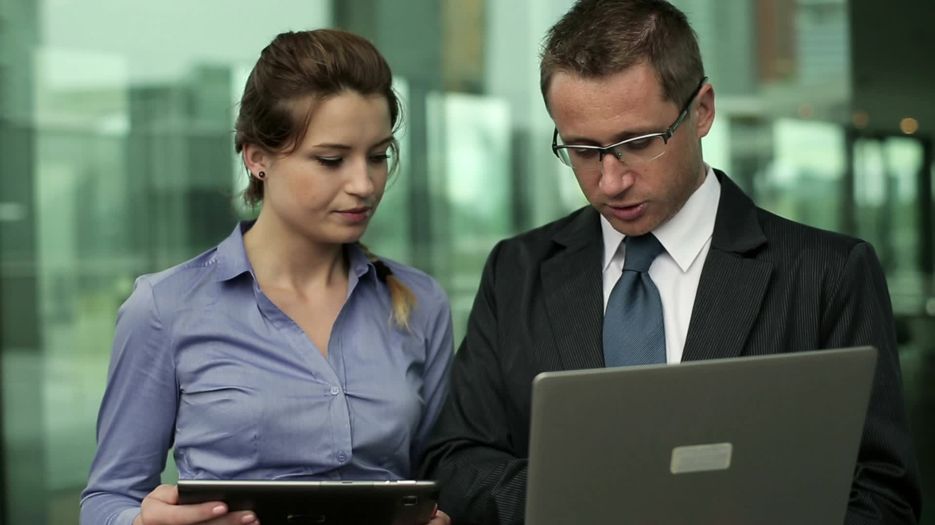 young-business-couple-tablet-and-footage-012184130_prevstill